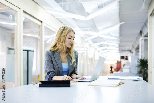 concentrated female administrative manager making working schedule