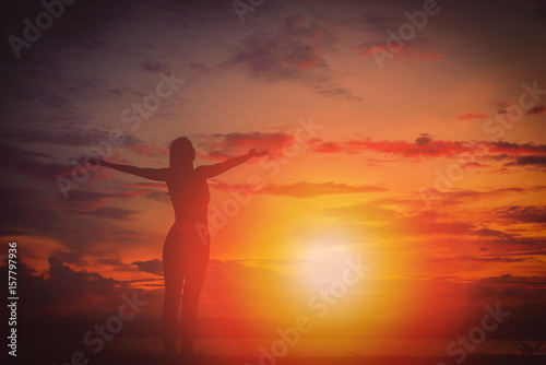 Fototapety, obrazy: Silhouette happy woman on the beach at sunset. Vintage tone