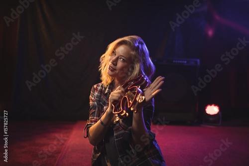 Wallpaper Mural Beautiful female musician playing tambourine in nightclub