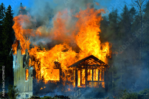 Fotografie, Obraz  Home on fire as the flames burst through the windows, door and roof of the house