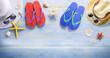 Beach Accessories On Blue wooden floor, banner