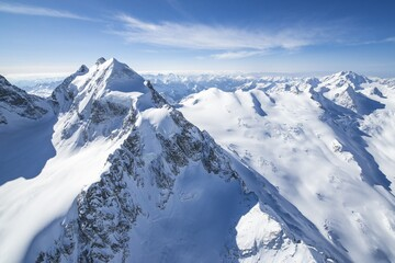 Aerial view of Piz Roseg sorrounded by huge glaciers. Val Roseg, Engadine, Canton of Grisons, Switzerland Europe