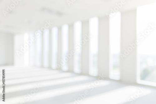 Fototapeta Store, interior, office, abstract defocused blurred background. heaven light Hope concept abstract blurred background... obraz