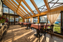 Tables In Modern Restaurant Interior And Big Skylight