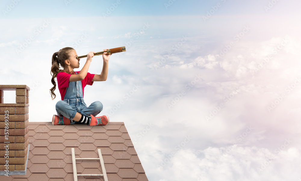 Fototapety, obrazy: Concept of careless happy childhood with girl looking in spyglass