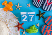 June 27th. Image Of June 27 Calendar On Blue Background With Summer Beach, Traveler Outfit And Accessories. Summer Time