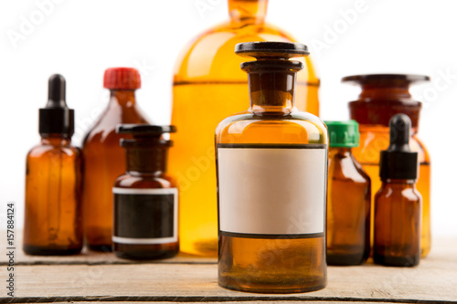 Pharmacy Container With Blank Label And Vintage Medical Bottles On The Background