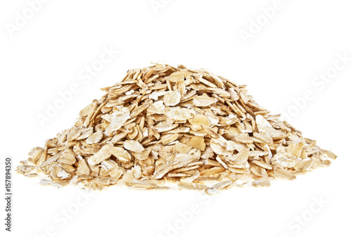 Oat flakes heap isolated on a white background