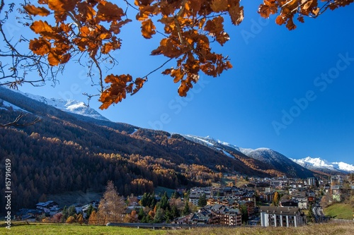 The bright colors of the autumn painting the popular ski resort of Aprica in Val Wallpaper Mural