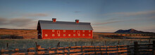 HDR Colorful Red Barn In Landscape At Sunrise With Cows, Fences And Mountains In Colorado