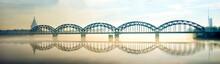 Silhouette Of Riga Railway Bridge In Foggy Early Morning