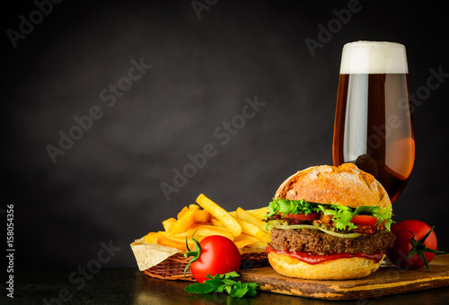 Fotografie, Obraz  Beer with Burger and French Fries on Copy Space