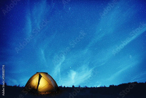 Poster Kamperen Illuminated camping tent at night