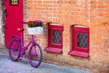 Fototapeta na wymiar pink bike standing by the wall