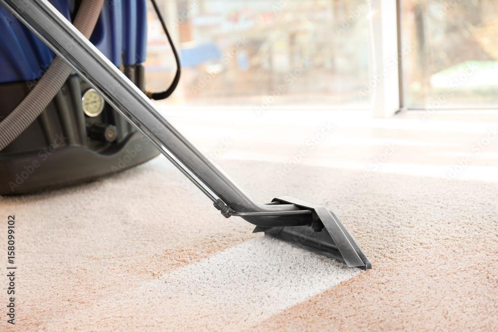 Fototapety, obrazy: Steam vapor cleaner removing dirt from carpet in flat