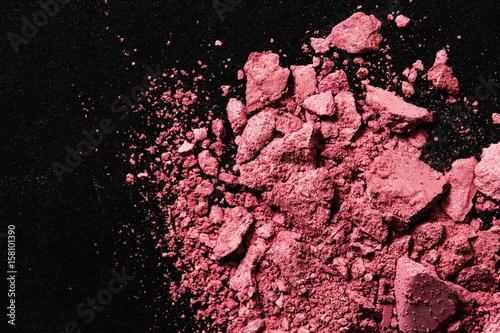 Valokuva  Broken pink blush on black table