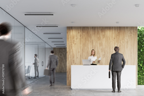 White reception, wooden office, people Poster Mural XXL