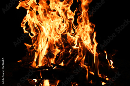 Fire flame. Bonfire background with bright vivid flame on black background.