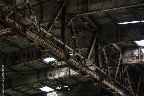 Staande foto Industrial geb. Part of old abandoned rusty building, dark creepy warehouse, dirty and broken