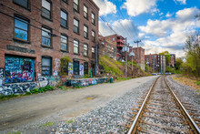Railroad Tracks And Old Buildings In Brattleboro, Vermont.