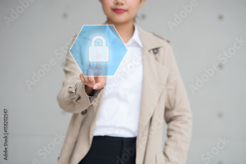 389a5d4bfdfd8 Double exposure of professional businessman touching security hexagonal  polygon button on a digital interface and city