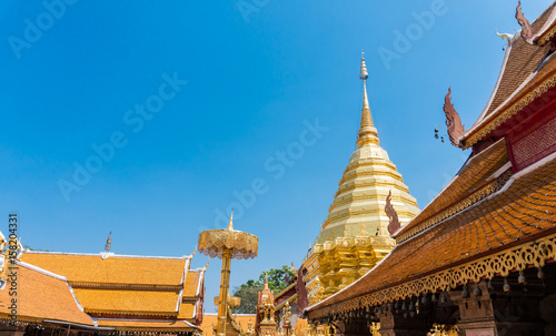 Foto op Aluminium Temple Roof of temple with blue sky background at at Wat Phra That Doi Suthep is most popular and place famous at Chiang Mai Thailand. Copy space