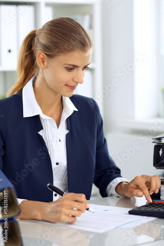 Modern business woman or confident female accountant in office Wallpaper Mural