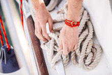 Hands Tie A Rope On The Yacht