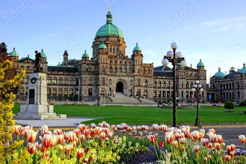 Historic British Columbia provincial parliament building with spring tulips, Victoria, BC, Canada