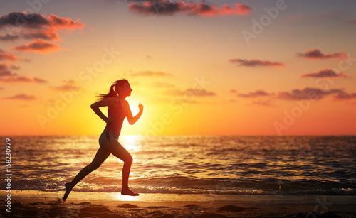 Fotografie, Obraz  Runner Woman Running In The Beach At Sunset