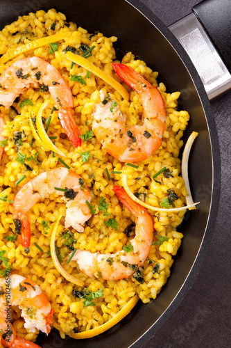 Delicious paella in pan.