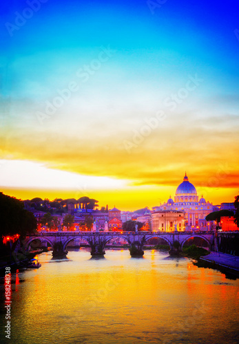 Foto op Aluminium Geel St. Peter's cathedral over bridge and river in Rome at orange sunset, Italy, retro toned