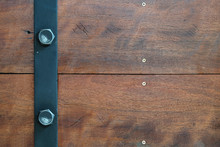 Box Of Dark Brown Wood And Black Steel Line And Nut Bolt With Patterns Background Texture Horizon.