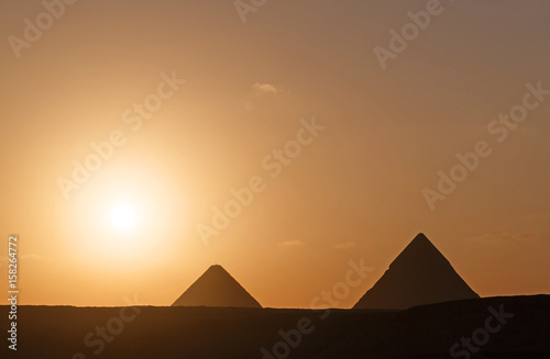 Fototapeta landscape with two pyramids at sunrise