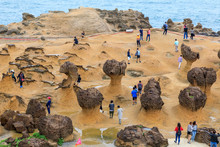 Tourists At The Yeliu (Yehliu) Geopark In Wanli District, New Taipei, Taiwan At A Rainy, Windy And Overcast Day