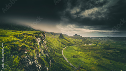 Spoed Foto op Canvas Heuvel Dramatic Rainy Clouds over Scottish Highlands in the Isle of Skye