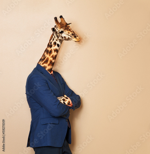 Giraffe headed businessman with his arms folded Wallpaper Mural