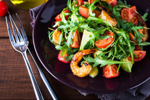 Fresh Salad Plate With Shrimp, Tomato, Avocado And Arugula (salad Rocket) On Wooden Background Close Up. Healthy Food. Clean Eating.
