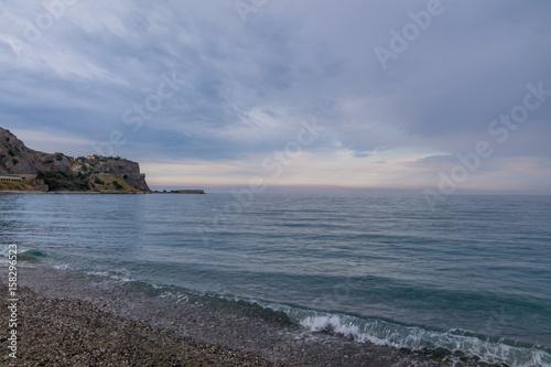 Fotografie, Obraz  Sunset on a Mediterranean beach of Ionian Sea - Bova Marina, Calabria, Italy