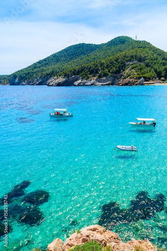 Foto op Plexiglas Panoramafoto s Fishing boats on turquoise sea water in Cala San Vicente bay, Ibiza island, Spain