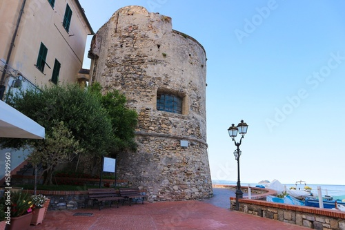 Ancient tower in touristic town Canvas Print