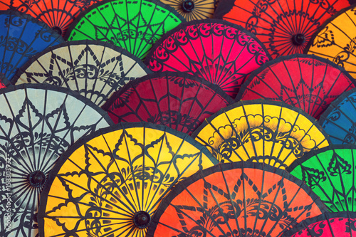 Fototapeta Traditional Burmese umbrellas. Colorful umbrellas at traditional street market in Bagan, Myanmar (Burma).Colored Burmese Umbrellas.Beautiful multi-colored background from Burmese umbrellas. obraz