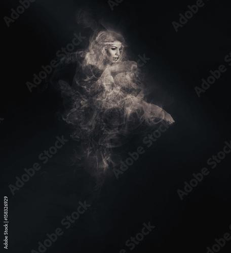 Fotografía Dancer from smoke on the dark background