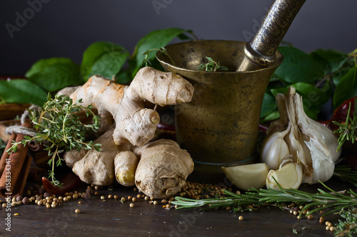 Different herbs and spices on a wooden table . Canvas Print