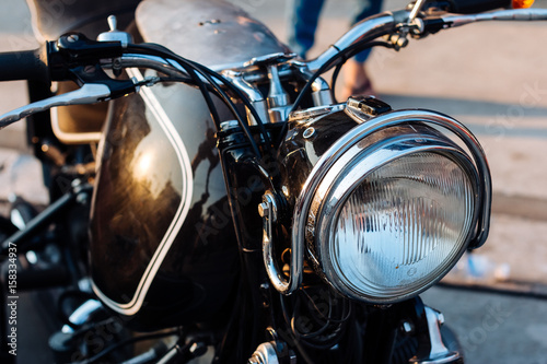 Close-up view on retro motorcycle headlights. плакат