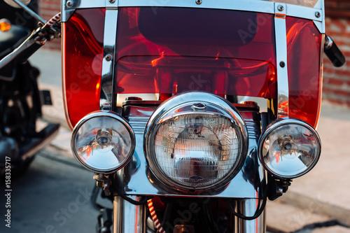 Close-up view on retro motorcycle headlights. Obraz na płótnie