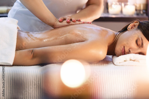 Fotobehang Spa Body massage and spa treatment in modern salon with candles