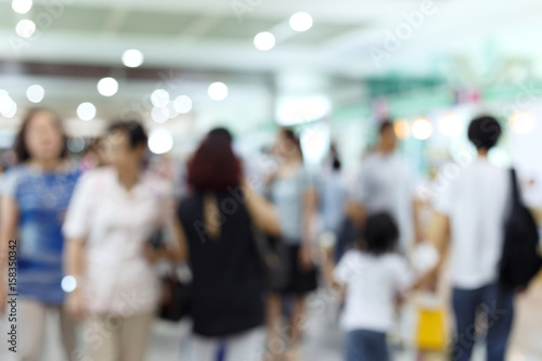 Valokuvatapetti crowd people traveler in airport terminal, image blur used background