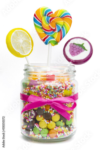 Foto op Aluminium Snoepjes Lollipops and candies in jar