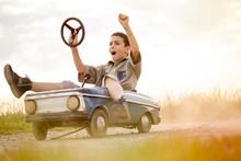 Kid Boy Driving Big Vintage Toy Car With A Teddy Bear